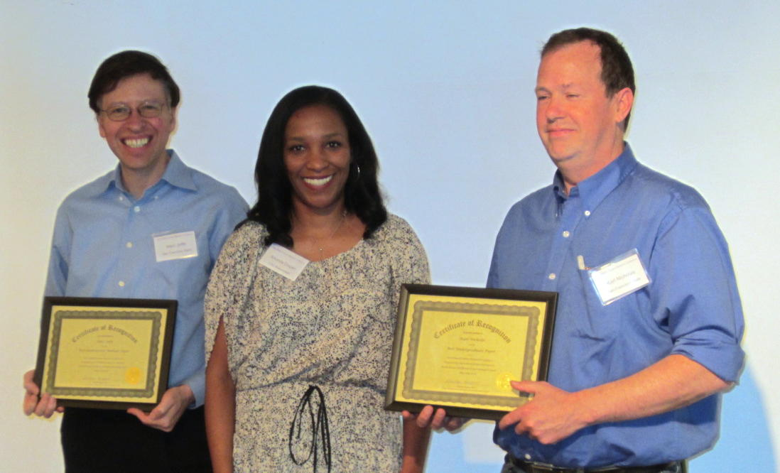 2013 Best Paper Award Winners , Marc Joffe (left) and Karl Nicholas (right), shown with 2012-2013 SSRIC Chair, Dr. Rhonda Dugan; not shown, Kathryn Gruszecki